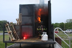 Fire Academy Instructor Setting up the Flashover Drill