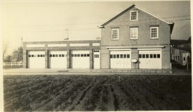 Firehouse with farmfield across the street.