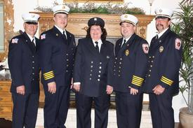 2009 Firefighter of the Year: Kathy Hartmann (center) pictured with CFD Chiefs and Captain