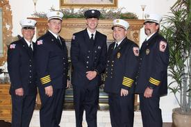 2009 ProbationaryFirefighter of the Year: Kyle Pumillo (center) pictured with CFD Chiefs and Captain