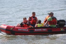 Suffolk Times Photo: CFD FF John Hinton & Paramedic Kyle Pumillo, on board the SFD Boat after pulling the man to safety..