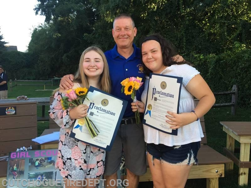 Maya and Cassandra with Chief Larry Behr