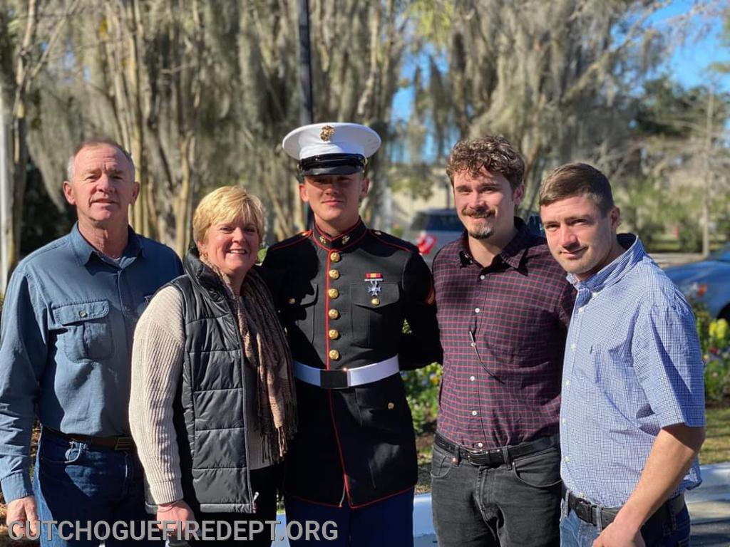 Brian and his family, his Dad Ed, Mom Karen, Brian, Brothers Zack and Sean